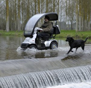 Mobility scooter through water.